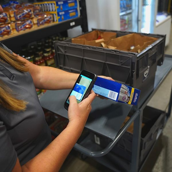 Person scanning at Micro-fulfillment pick station